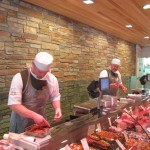 Craft butchers preparing meat for customers at James Whelan Butchers