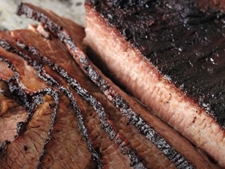 Brined beef brisket on the bone with BBQ sauce